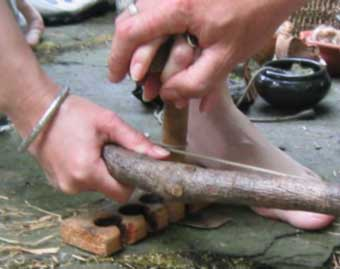 A helping hand - learning to steady the spindle when making fire