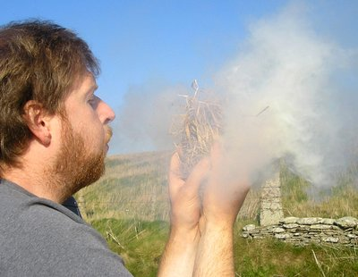 Blowing air into a tinder nest in windy Orkney