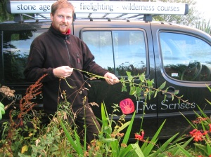 Malcolm making nettle cordage - with tour car behind