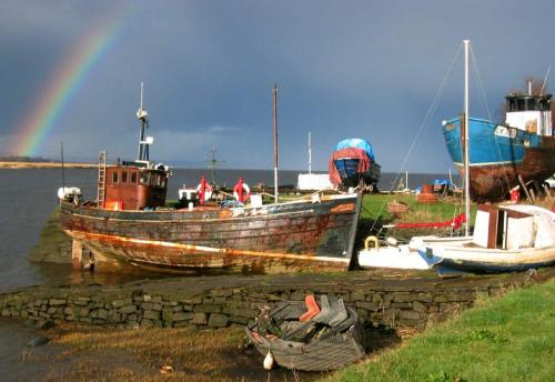 Boats beside Tay with Rainbow